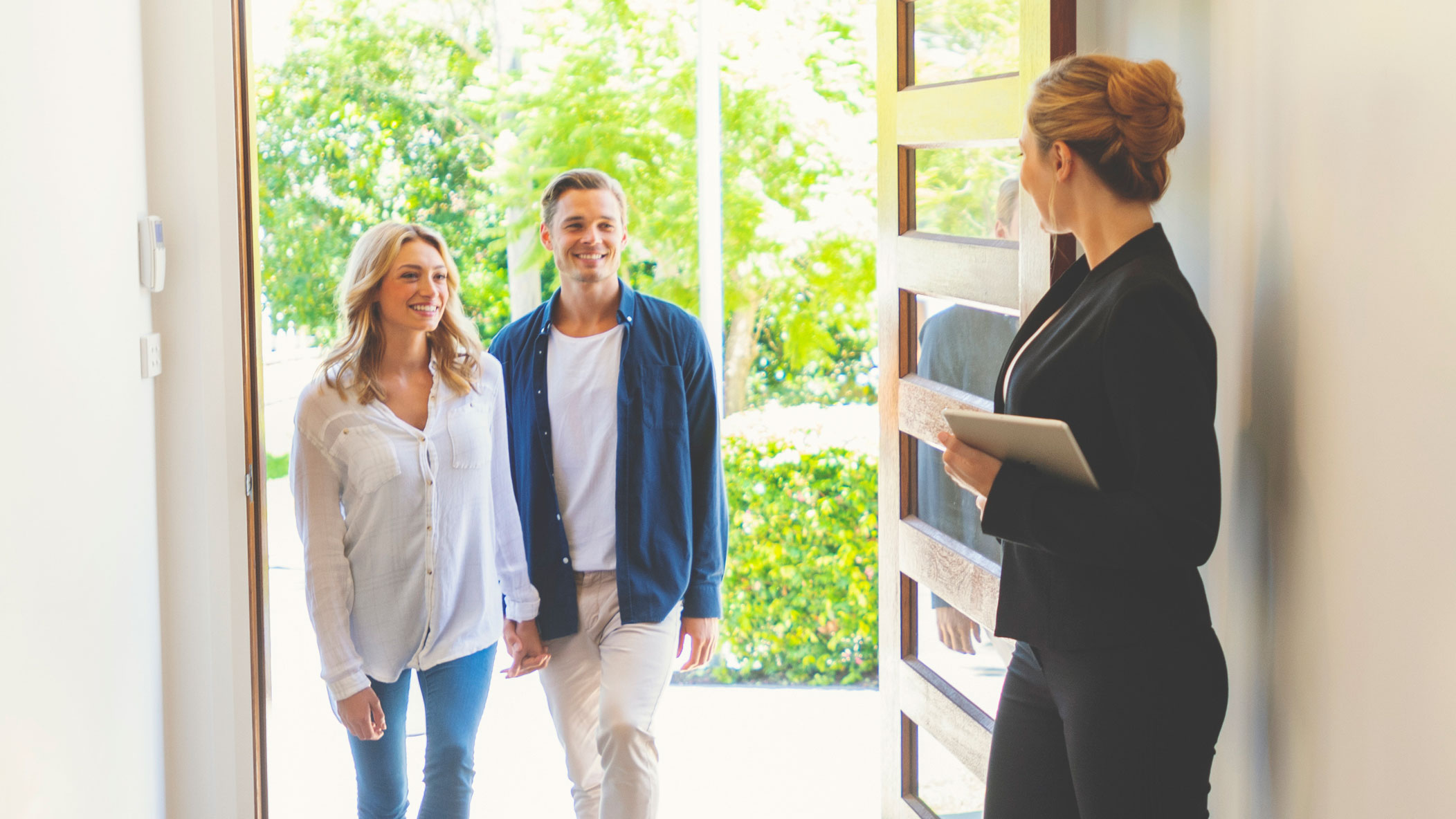 Realtor Showing Couple Modern Home